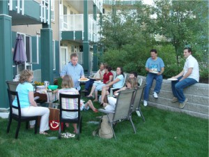 Photo of a group of people at an outdoor summer BBQ celebrating Stephen Oakleaf's birthda